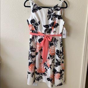 Scoop neck, A-line dress with sash around waist